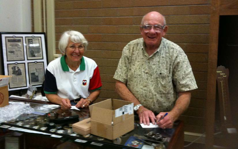 Julia and Stan Mueller preparing exhibits.